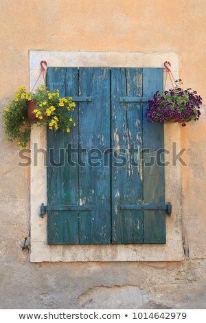 Window with blue shutters Stock photo © dinozzaver