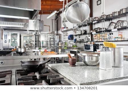Variety of kitchen utensils on counter Stock photo © dacasdo