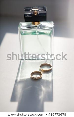 Stock photo:  perfume  and wedding rings