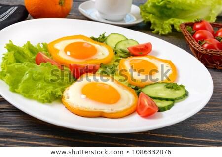 Сток-фото: Fried Egg In Sweet Paprika