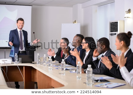 Applause for a presentation in business meeting Stock photo © Kzenon