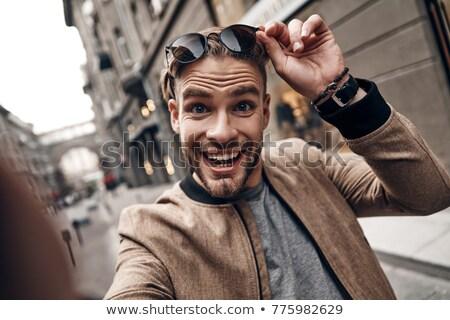 Játékos fiatalember portré mosolyog fiatal vicces Stock fotó © georgemuresan