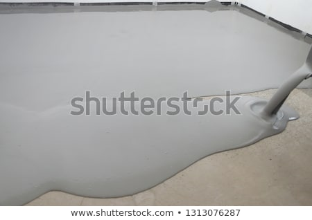 self leveling compound spreading  Stock photo © Virgin