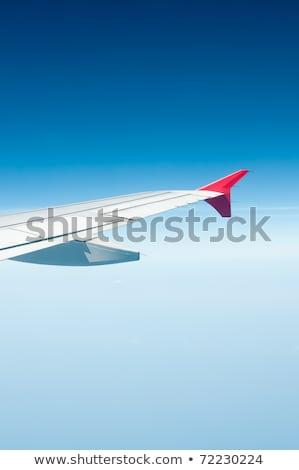 repülőgép · szárny · felhők · kilátás · repülőgép · tiszta · égbolt - stock fotó © meinzahn