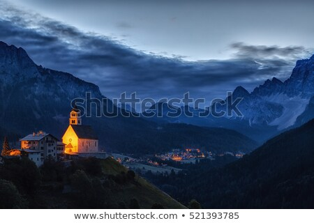 Dolomites Church Colle Santa Lucia at sunrise, Alps, Italy Stock photo © fisfra