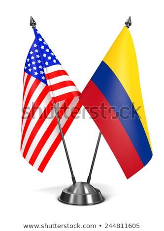 США Колумбия миниатюрный флагами изолированный белый Сток-фото © tashatuvango