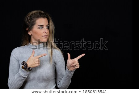 happy blond female calling at phone looking left stock photo © dash