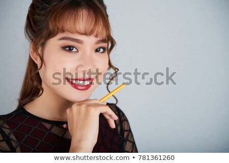 Gorgeous young Vietnamese woman daydreaming Stock photo © smithore