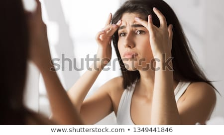 Young woman checking her face skin Stock photo © stokkete