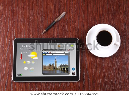 tablet on a wooden desk   science and technology stock photo © zerbor