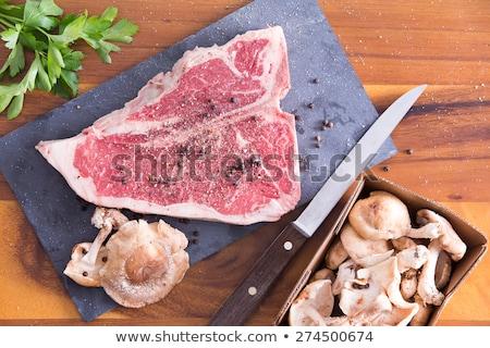 marinated t bone steak with parsley and mushrooms stock photo © ozgur