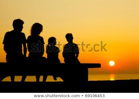 rodziny · cztery · zachód · słońca · ręce · para · piękna - zdjęcia stock © paha_l