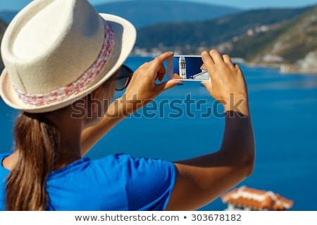 Girl in hat making photos of the smartphone Perast in Boka Kotor Stock photo © vlad_star