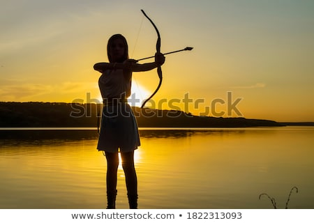 woman with bow and arrow.  Stock photo © godfer