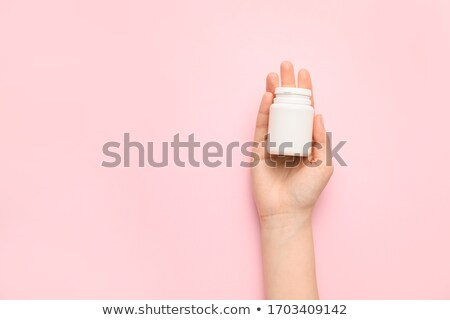 Woman holding bottle with antidepressant pills  Stock photo © deandrobot