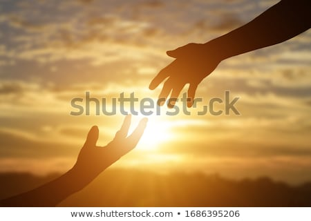 Climber reaching for a helping-hand. stock photo © gregepperson
