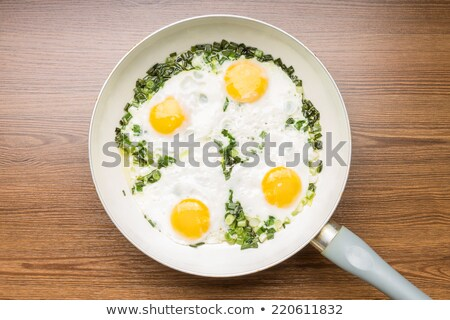 Four fried eggs Stock photo © Digifoodstock