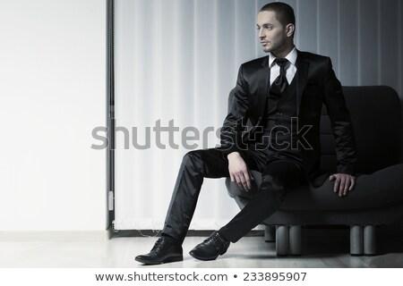 Elegáns férfi öltöny nyakkendő ül zsámoly Stock fotó © feedough