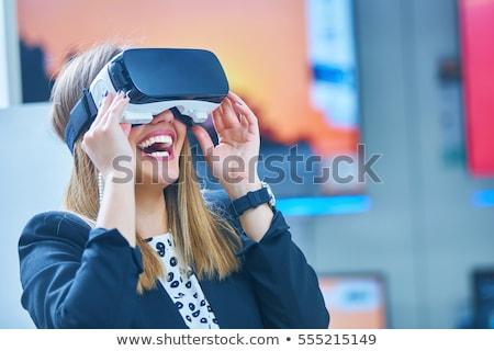 Fiatal nő visel virtuális valóság berendezés kép Stock fotó © deandrobot