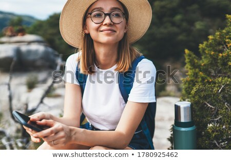 Portrait pretty hipster Woman sitting on mountain top  Stock photo © Yatsenko
