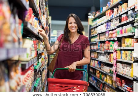 Happy woman looking camera in mall Stock photo © deandrobot