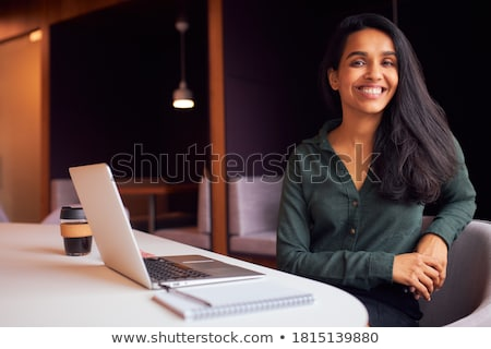 Stock photo: Businesswoman Sitting In Boardroom With Laptop Smiling