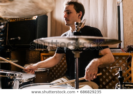 man playing drum kit at sound recording studio Stock photo © dolgachov