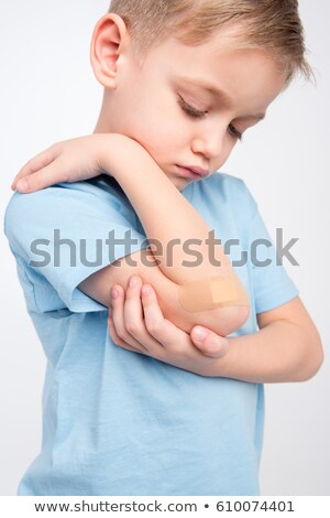 Little boy with patch on elbow Stock photo © LightFieldStudios