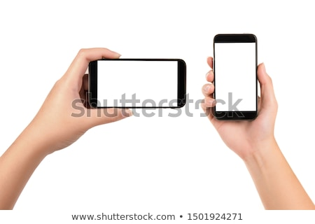 Young girl hand holding black smart phone isolated on white Stock photo © manaemedia