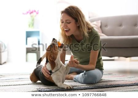 jonge · vrouw · hond · home · portret · witte · vreugde - stockfoto © is2