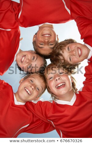 Low viewpoint of young football team Stock photo © IS2