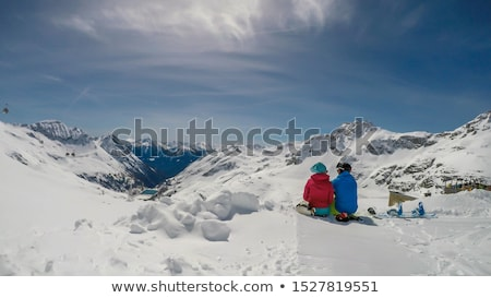 couple sitting in the snow hugging Stock photo © IS2