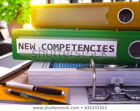 green ring binder with inscription new competencies stock photo © tashatuvango