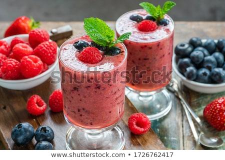 Smakelijk bes smoothie vers bessen stro Stockfoto © YuliyaGontar