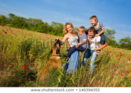 family walking in field of flowers stock photo © is2