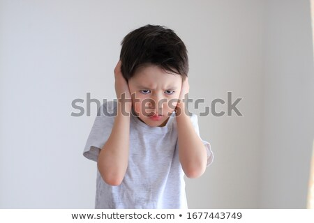 Asian boy covered ears Stock photo © szefei