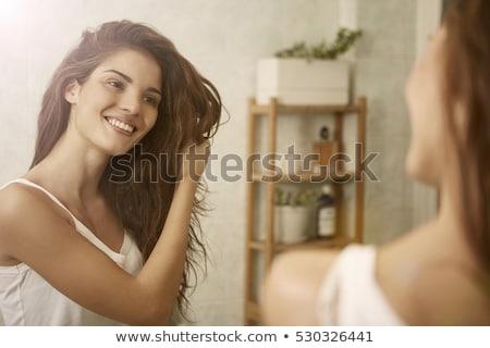 Kadın dokunmak saç kadın gülen sevinç Stok fotoğraf © IS2