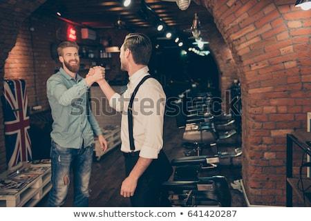 Mosolyog barátságos férfi modern frizura szakállas Stock fotó © Giulio_Fornasar