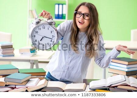 Fiatal női diák vizsgák sok könyvek Stock fotó © Elnur