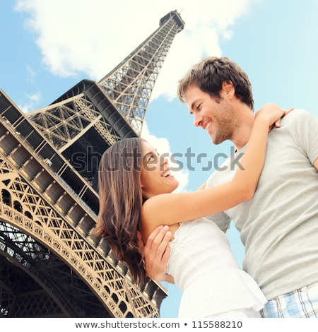 Paris Eiffel tower romantic couple embracing kissing in front of Eiffel Tower, Paris, France. Stock photo © artfotodima