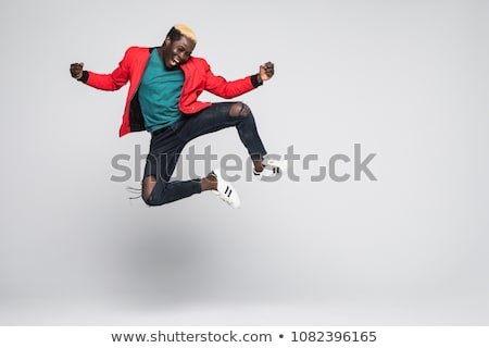 Full length portrait of a cheerful young afro american man Stock photo © deandrobot