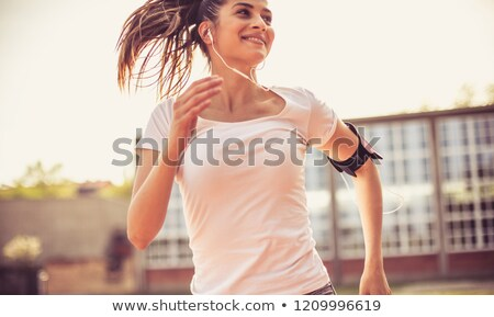 Close up of cheerful young sportswoman Stock photo © deandrobot