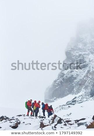 Turista fagy kövek hegy túrázik időjárás Stock fotó © Kotenko