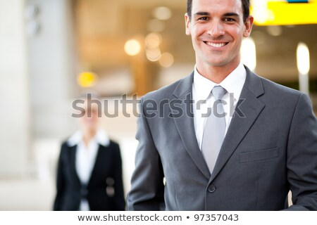Portrait of a cheerful young businessman dressed in suit Stock photo © deandrobot