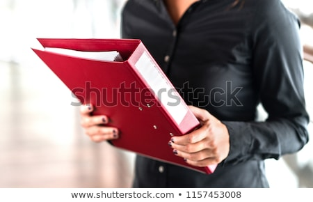 businesswoman or realtor with folder at office stock photo © dolgachov