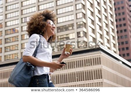 счастливым · молодые · черную · женщину · ходьбе · городской · улице · улыбаясь - Сток-фото © Stasia04