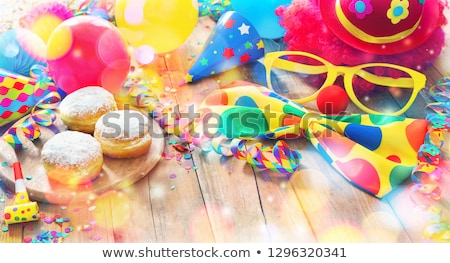 Krapfen, Berliner or  donuts with streamers and confetti stock photo © brebca