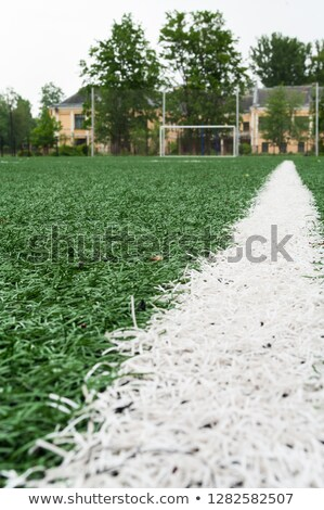 Football soccer field. Low angle image of green turf on soccer pitch Stock photo © matimix