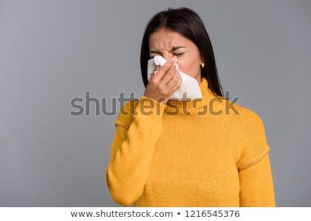 Beteg nő áll izolált szürke fal Stock fotó © deandrobot