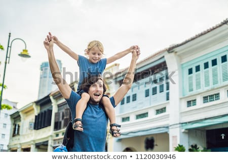 Dad and son in the background of Old houses in the Old Town of Georgetown, Penang, Malaysia Stock photo © galitskaya